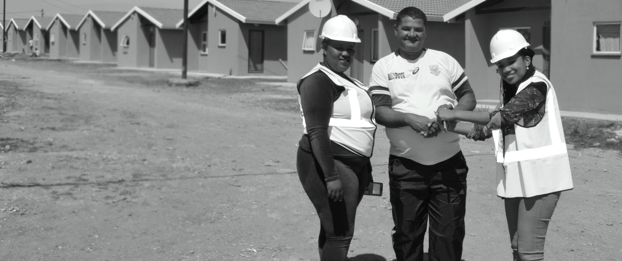 Ntsiki handing over the keys to a happy new home owner
